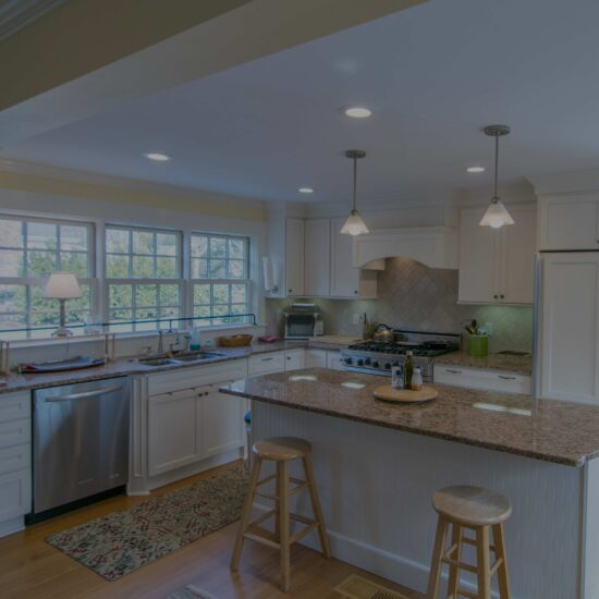 traditional kitchen remodel in dartmouth with white cabinets and beige granite counter tops