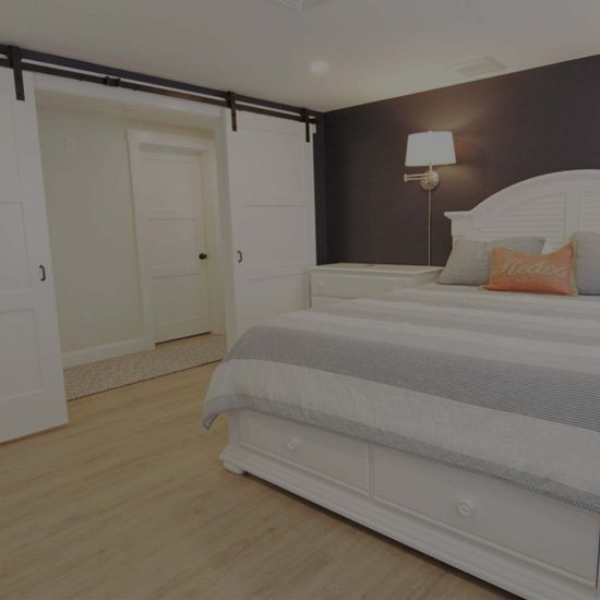 bedroom with rolling barn door - cottage restoration
