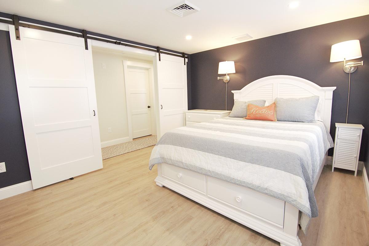 bedroom-with-rolling-barn-doors-renovation